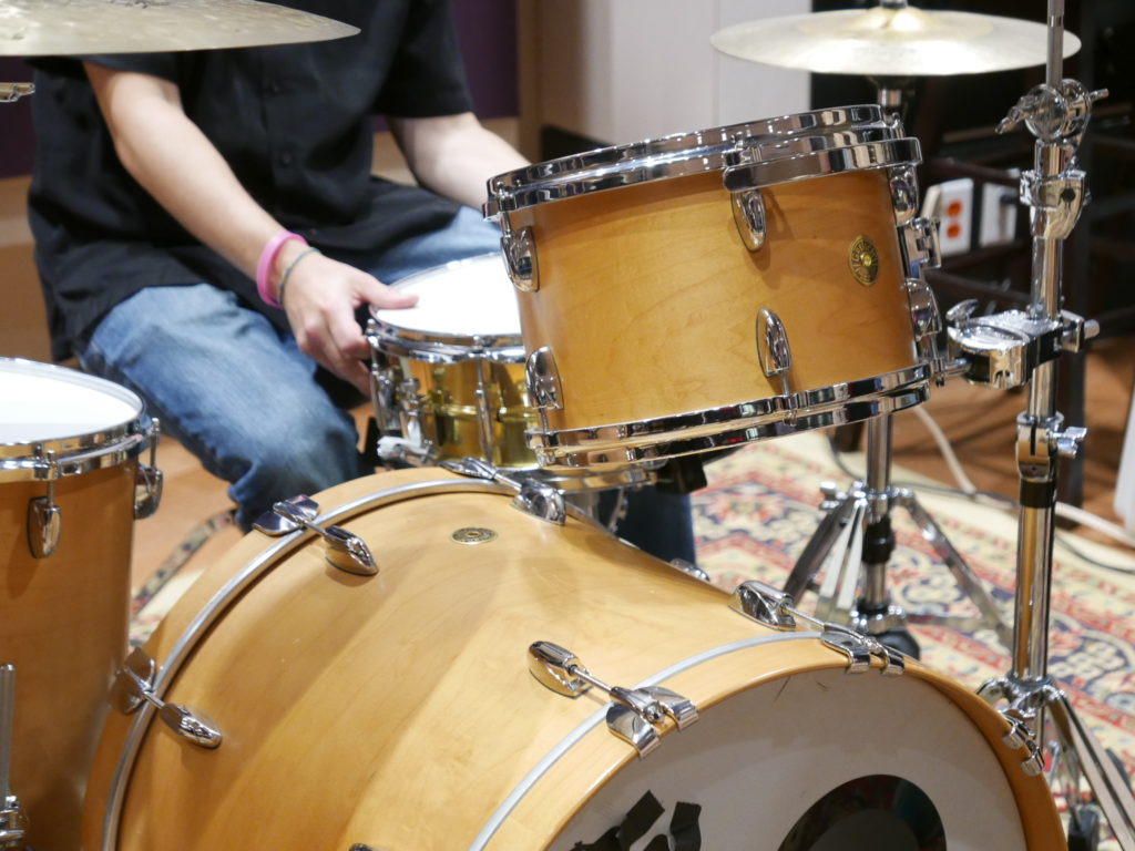 Person playing the drums.