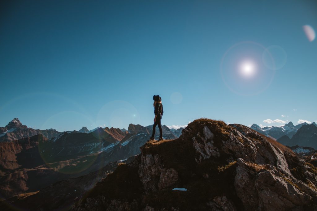A woman standing on a mountaintop.
