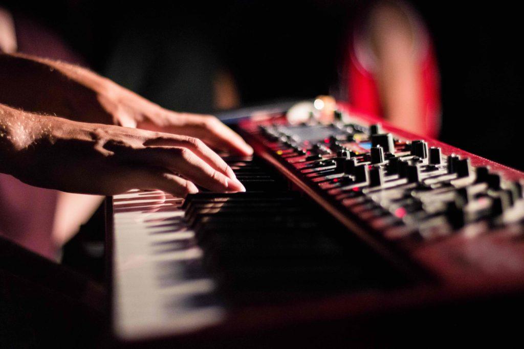 A musician playing a keyboard.