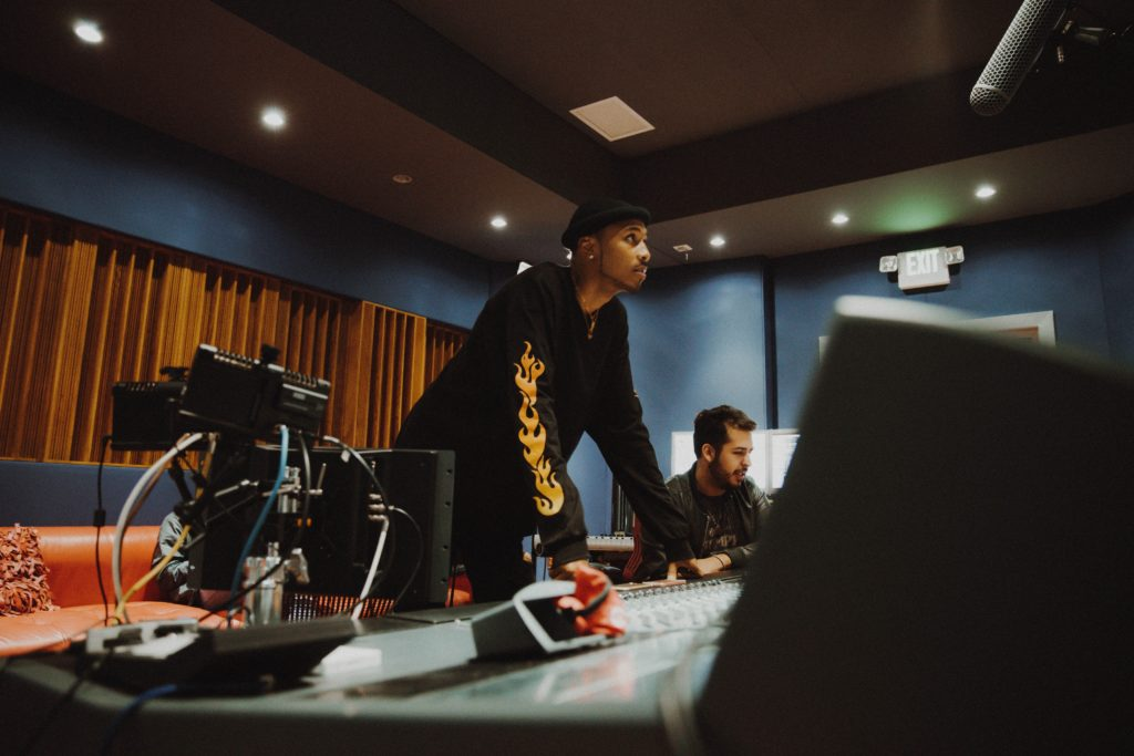 A music producer in a recording studio.