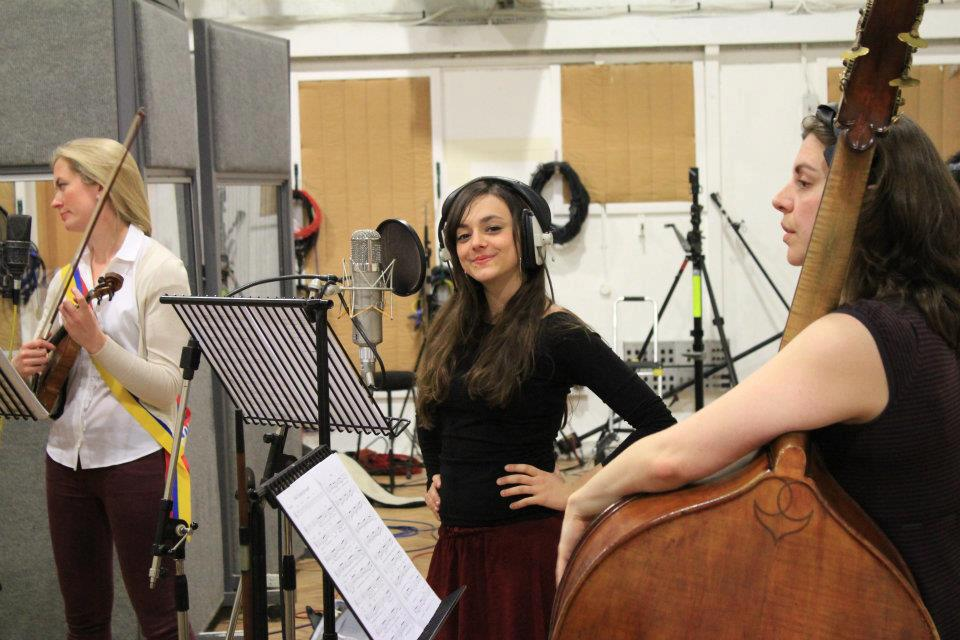 Author Eirini Tornesaki is pictured here recording vocals at the famed Abbey Road studios.