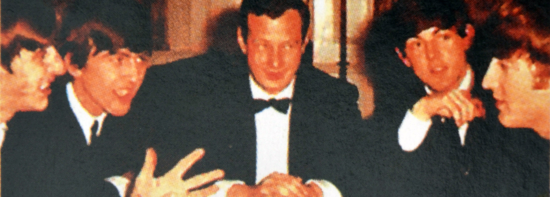Brian Epstein with the Beatles.