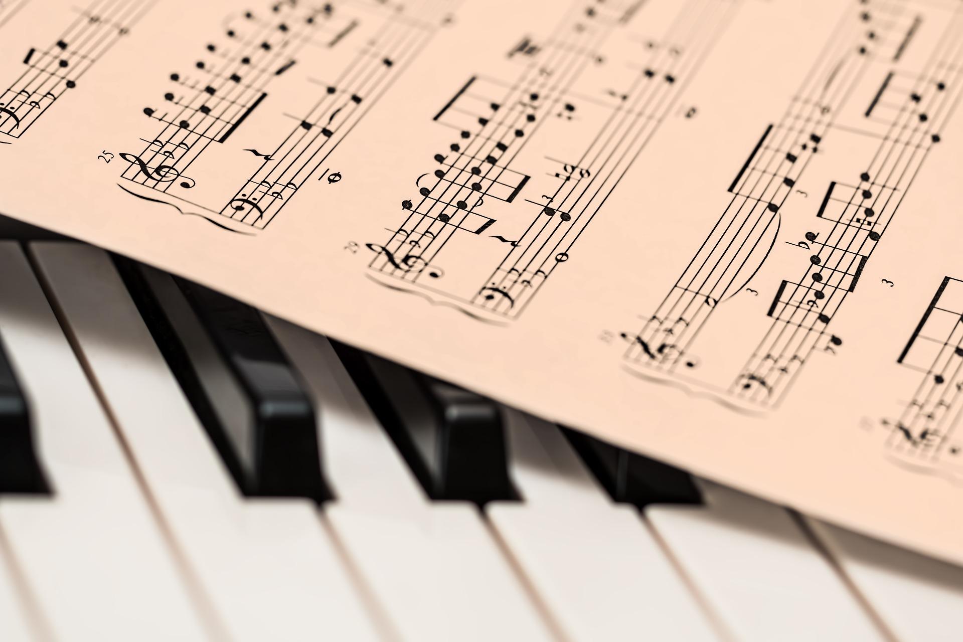 A piece of sheet music on piano keys.