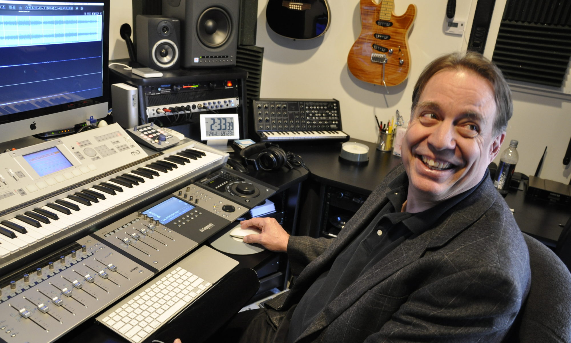 Peter Bell sits at a sound board.