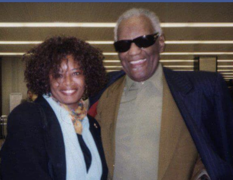 Regina Brown-Ross and Ray Charles.