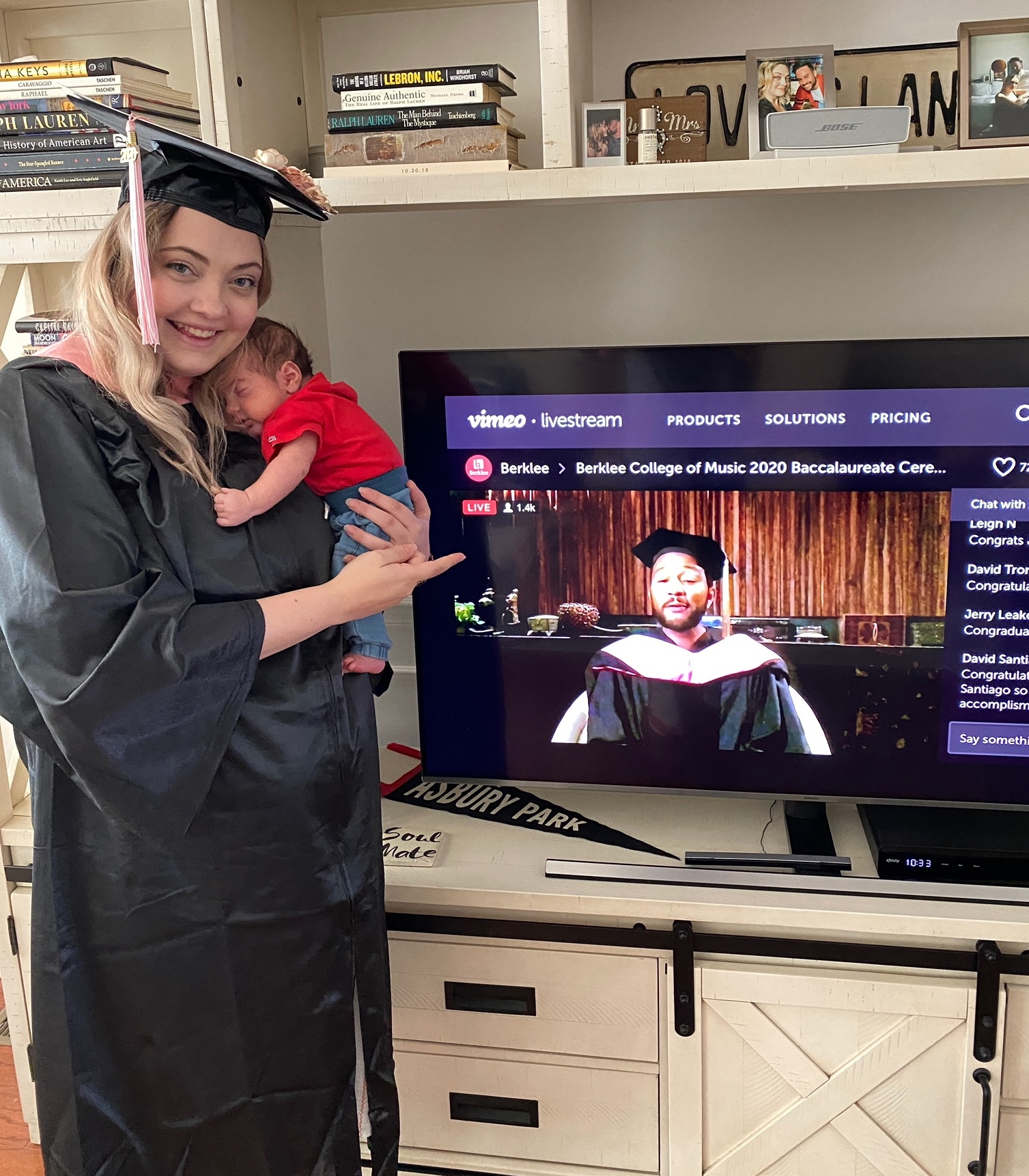 Berklee Online graduate Carrie Lane Pearlman watches the John Legend Tribute with her newborn son during the virtual Commencement concert.
