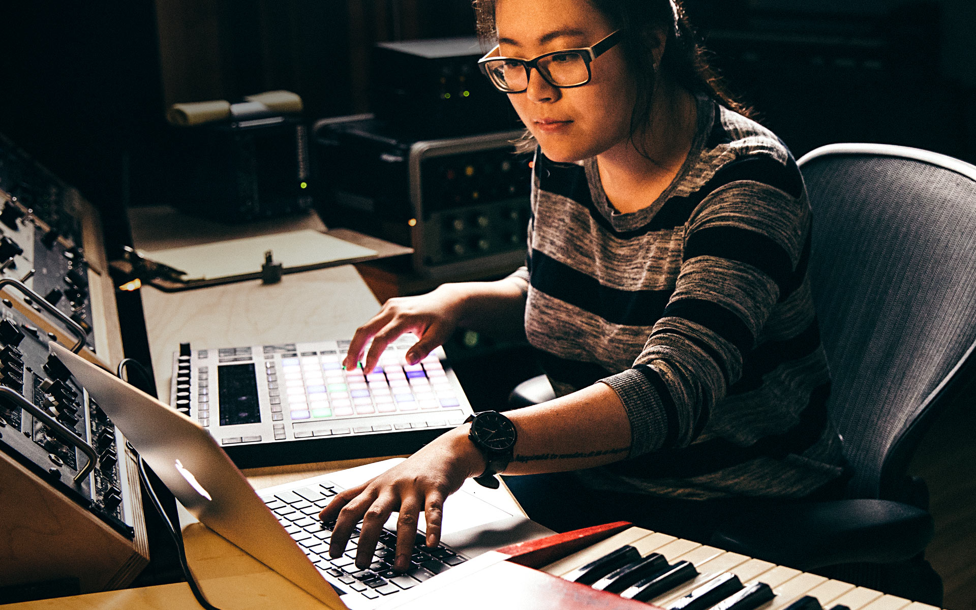 Woman scoring music for video games.