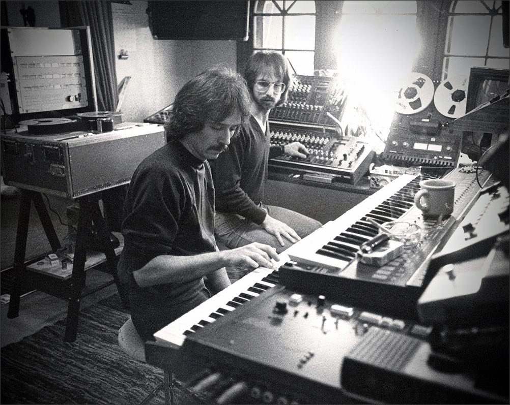 "Director and composer John Carpenter sits with technologist Alan Howarth at Pi West Studio, working on the soundtrack for the 1978 horror film, ""Halloween."""