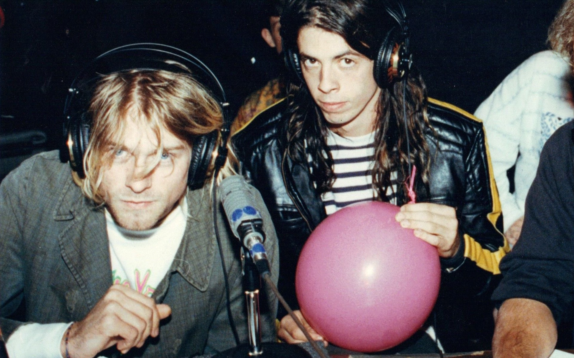 """Kurt Cobain and Dave Grohl of Nirvana sit with WFNX DJ Kurt St. Thomas, doing a radio interview the evening before Nirvana release their breakthrough album, """"Nevermind"""" in 1991."""
